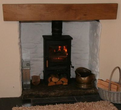 fireplace with woodburner
